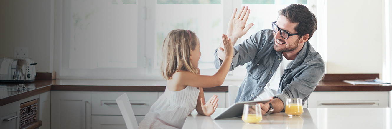 father and daughter high five in kitchen