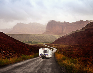 RV driving through red rock canyons