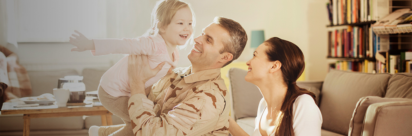 service member and family in living room of home