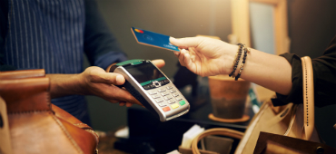 Shopper paying with Credit Union West card featuring new debit card design
