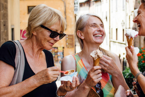 Women laughing with ice cream