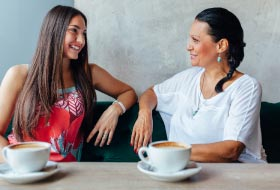 Two women chatting at coffee shop