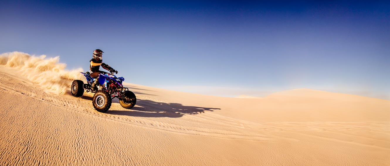Person riding an ATV in desert