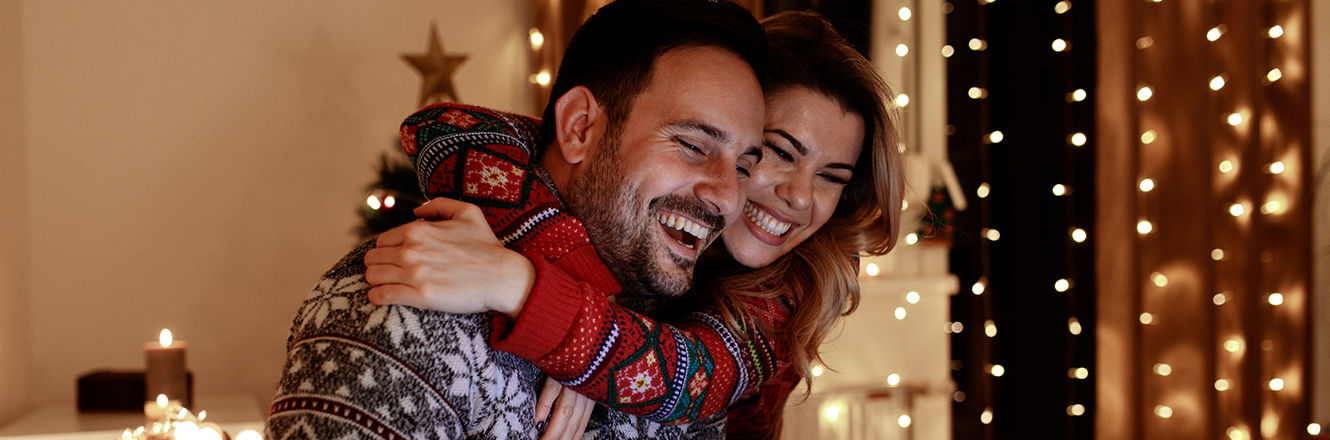 couple hugging in holiday sweater