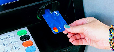inserting debit card into ATM