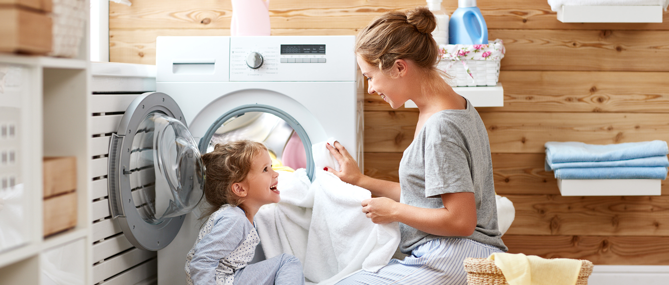 Mother and daughter folding laundry.